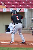 Lansing Lugnuts shortstop Jorge Flores #1 bats during a game against the Cedar Rapids Kernels at Veterans Memorial Stadium on April 29, 2013 in Cedar Rapids, Iowa. (Brace Hemmelgarn/Four Seam Images)