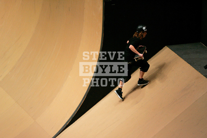 Shaun White climbs back up the ramp while he competes in the Men's Skateboarding Vert finals at the Staples Center during X-Games 12 in Los Angeles, California on August 3, 2006.