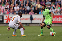 ( L-R ) Wayne Routledge of Swansea City against Gael Clichy of Manchester City during the Swansea City FC v Manchester City Premier League game at the Liberty Stadium, Swansea, Wales, UK, Sunday 15 May 2016