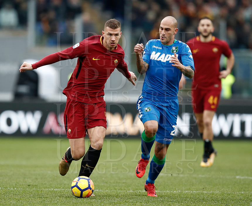 Calcio, Serie A: AS Roma - Sassuolo, Roma, stadio Olimpico, 30 dicembre 2017.<br /> Roma's Edin Dzeko (l) in action with Sassuolo's Paolo Cannavaro (r) during the Italian Serie A football match between AS Roma and Sassuolo at Rome's Olympic stadium, 30 December 2017.<br /> UPDATE IMAGES PRESS/Isabella Bonotto