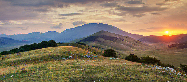 Sunset on the Piano Grande, Great Plain, of Castelluccio di Norcia, Parco Nazionale dei Monti Sibillini ,  Apennine Mountains,  Umbria, Italy.