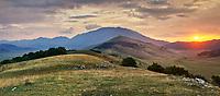 Sunset on the Piano Grande, Great Plain, of Castelluccio di Norcia, Parco Nazionale dei Monti Sibillini ,  Apennine Mountains,  Umbria, Italy.