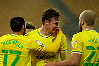 6th April 2021; Carrow Road, Norwich, Norfolk, England, English Football League Championship Football, Norwich versus Huddersfield Town; Kieran Dowell of Norwich City celebrates his goal with Emi Buendia and Teemu Pukki for 5-0 in the 42nd minute