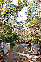 wooden gate with pillars of rock