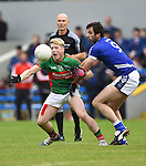 Keelan Sexton of  Kilmurry Ibrickane in action against John Galvin of Cratloe during their senior football final replay at Cusack park. Photograph by John Kelly.