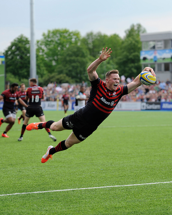 Chris Ashton of Saracens does his trademark swallow dive to score a try during the Aviva Premiership semi final match between Saracens and Harlequins at Allianz Park on Saturday 17th May 2014 (Photo by Rob Munro)