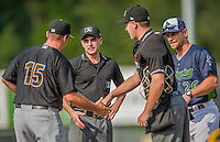 12 July 2015: Minor League Umpire David Perez and Vince Jackson (working home plate) greet managers at home plate prior to a game between the Vermont Lake Monsters and the West Virginia Black Bears at Centennial Field in Burlington, Vermont. The Lake Monsters came back from a 4-0 deficit to defeat the Black Bears 5-4 in NY Penn League action. Mandatory Credit: Ed Wolfstein Photo *** RAW Image File Available ****
