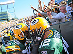 Green Bay Packers receiver Greg Jennings, left, grabs quarterback Aaron Rodgers after Rodgers' sneak for a touchdown against the Miami Dolphins during the fourth quarter of the game at Lambeau Field in Green Bay, Wis., on Oct. 17, 2010.