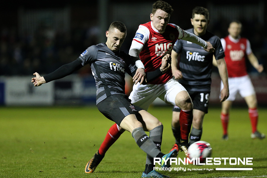 Dylan Connolly of Dundalk with Dean Clarke of St Patrick's during the SSE Airtricity League Premier Division game between St Patrick's Athletic and Dundalk FC on Monday 12th March 2018 at Richmond Park, Dublin. Photo By: Michael P Ryan