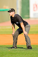 Umpire Morgan Day handles the calls on the bases during the Appalachian League game between the Pulaski Mariners and the Bluefield Blue Jays at Bowen Field on July 1, 2012 in Bluefield, West Virginia.  The Mariners defeated the Blue Jays 4-3.  (Brian Westerholt/Four Seam Images)