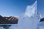 A shard of aufeis reaches toward the arctic sky.