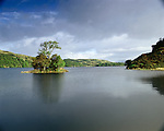Crannog, Loch Nell, Nr Ford Argyle and Bute Scotland . Celtic Britain published by Orion. Small circular island were once fortified homes of lake dwelling Iron Age families