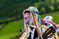 """A man, wearing colorful costume, play guitar during the Inti Raymi festival in Pichincha province, Ecuador, 27 June 2010. Inti Raymi, """"Festival of the Sun"""" in Quechua language, is an ancient spiritual ceremony held in the Indian regions of the Andes, mainly in Ecuador and Peru. The lively celebration, set by the winter solstice, goes on for various days. The highland Indians, wearing beautiful costumes, dance, drink and sing with no rest. Colorful processions in honor of the God Inti (Sun) pass through the mountain villages giving thanks for the harvest and expressing their deep relation to the Mother Earth (Pachamama)."""