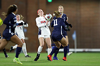 CHAPEL HILL, NC - NOVEMBER 16: A.B. Hawkins #8 of Belmont University and Emily Fox #11 of the University of North Carolina challenge for the ball during a game between Belmont and North Carolina at UNC Soccer and Lacrosse Stadium on November 16, 2019 in Chapel Hill, North Carolina.