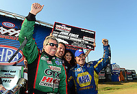 Sept. 22, 2012; Ennis, TX, USA: NHRA funny car driver John Force celebrates with Ron Capps after winning the Traxxas Funny Car Shootout during qualifying for the Fall Nationals at the Texas Motorplex. Mandatory Credit: Mark J. Rebilas-