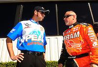 Nov 14, 2010; Pomona, CA, USA; NHRA top fuel dragster driver T.J. Zizzo (left) talks with Cory McClenathan during the Auto Club Finals at Auto Club Raceway at Pomona. Mandatory Credit: Mark J. Rebilas-