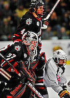 28 January 2012: Northeastern University Huskies' goaltender Chris Rawlings, a Junior from North Delta, British Columbia, in third period action against the University of Vermont Catamounts at Gutterson Fieldhouse in Burlington, Vermont. The Huskies defeated the Catamounts 4-2 in the second game of their 2-game Hockey East weekend series. Mandatory Credit: Ed Wolfstein Photo