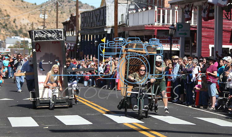 Alice in Potty Land, left, and the Commode Commandos race during the first round of Outhouse Races in Virginia City, Nev, on Saturday, Oct. 1, 2011. Competition continues Sunday at noon..Photo by Cathleen Allison