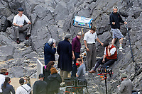 Pictured: Hugh Laurie, Will Poulter and Conieth Hill. Friday 18 June 2021<br /> Re: Film set with a scene being filmed with Hugh Laurie as a director at Three Cliffs Bay in the Gower Peninsula, Wales, UK.