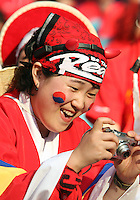 Korea Republic fan takes a photo. The Korea Republic and France played to a 1-1 tie in their FIFA World Cup Group G match at the Zentralstadion, Leipzig, Germany, June 18, 2006.