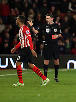 Pictured L-R: Ryan Bertrand of Southampton is shown a red card by match referee Michael Oliver for his foul against Modou Barrow Sunday 01 February 2015<br />