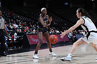 WINSTON-SALEM, NC - FEBRUARY 06: Destinee Walker #24 of the University of Notre Dame passes the ball past Gina Conti #5 of Wake Forest University during a game between Notre Dame and Wake Forest at Lawrence Joel Veterans Memorial Coliseum on February 06, 2020 in Winston-Salem, North Carolina.