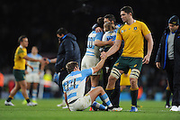 Rob Simmons of Australia helps Santiago Cordero of Argentina to his feet after the Semi Final of the Rugby World Cup 2015 between Argentina and Australia - 25/10/2015 - Twickenham Stadium, London<br /> Mandatory Credit: Rob Munro/Stewart Communications