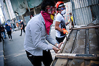 copyright : Magali Corouge /Documentography<br />Taksim square, Istanbul, Turkey, the 11th of June 2013. <br /><br />Protestors building barricades while police forces are setting up on the main square. Police started to evacuate Taksim square, on the early morning of the 11th of June, after more than a week of occupation.