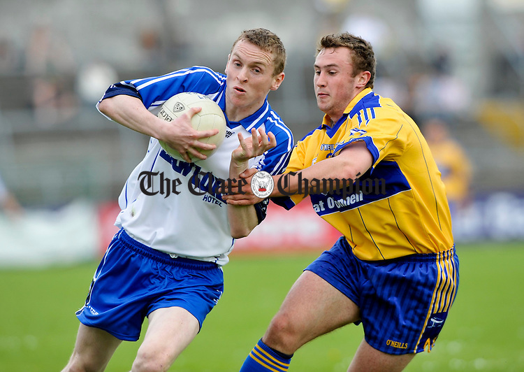 Maurice O Gorman of Waterford is tackled by Clare's David Connole during their senior championship game in Cusack Park. Photograph by John Kelly.