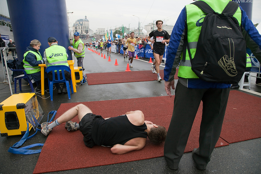 Moscow, Russia, 12/09/2010..A runner collapses after crossing the finish line at the 30th annual Moscow International Marathon.