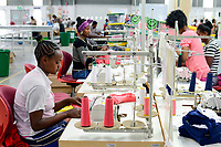 ETHIOPIA , Southern Nations, Hawassa or Awasa, Hawassa Industrial Park, chinese-built for the ethiopian government to attract foreign investors with low rent and tax free to establish a textile industry and create thousands of new jobs, textile company Hela Indochine Apparel PLC a joint venture of sri lankan and chinese companies, green smiley marking for good performance, yellow mark for bad performance / AETHIOPIEN, Hawassa, Industriepark, gebaut durch chinesische Firmen fuer die ethiopische Regierung um die Hallen fuer Textilbetriebe von Investoren zu vermieten, Textilfabrik Hela Indochine Apparel PLC