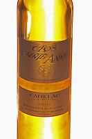 A backlit bottle of golden Clos Sainte Anne Grains Nobles sweet Cadillac wine from vintage 2001  Chateau Thieuley La Sauve Majeure  Entre-deux-Mers  Bordeaux Gironde Aquitaine France
