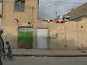 Iraq 2011<br /> In the old city of Erbil, near the citadel, a street ,houses, a young boy with his bike and an imam  <br /> Irak 2011 <br /> Dans la vieille ville d'Erbil, une rue avec les maisons, un enfant avec un velo et un imam