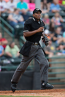 Home plate umpire Edwin Moscoso hustles down the first base line as he watches the flight of the baseball during the South Atlantic League game between the West Virginia Power and the Hickory Crawdads at L.P. Frans Stadium on August 15, 2015 in Hickory, North Carolina.  The Power defeated the Crawdads 9-0.  (Brian Westerholt/Four Seam Images)