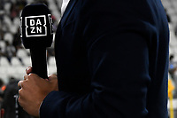 A DAZN journalist holds a microphone during the Serie A 2021/2022 football match between Juventus FC and Empoli Calcio at Allianz stadium in Torino (Italy), August 28th, 2021. Photo Andrea Staccioli / Insidefoto
