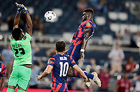 KANSAS CITY, KS - JULY 15: Daryl Dike #11 of the United States heads a ball past Gilles Meslien #23 of Martinique during a game between Martinique and USMNT at Children's Mercy Park on July 15, 2021 in Kansas City, Kansas.