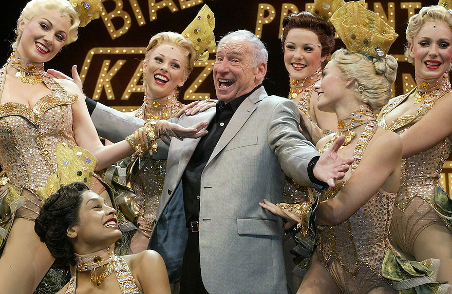 """Legendary funny-man Mel Brooks hams it up with chorus girls during a media call for his musical """"The Producers"""" at the Princess Theatre in Melbourne. - pic by Trevor Collens"""