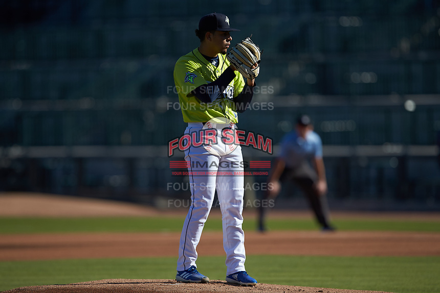 Columbia Fireflies starting pitcher Jose Butto (45) looks to his catcher for the sign against the Rome Braves at Segra Park on May 13, 2019 in Columbia, South Carolina. The Fireflies walked-off the Braves 2-1 in game one of a doubleheader. (Brian Westerholt/Four Seam Images)