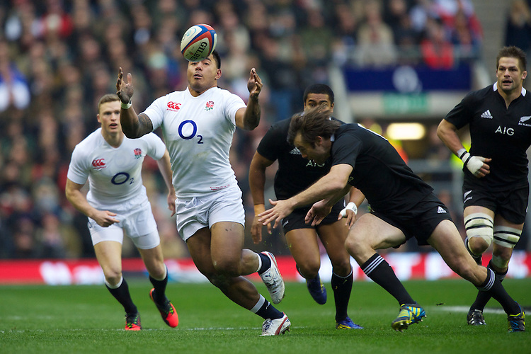 Manu Tuilagi of England keeps his eye on the ball during the QBE Autumn International match between England and New Zealand at Twickenham on Saturday 01 December 2012 (Photo by Rob Munro)