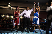 England.London. 19th September 2014.<br /> The referee holds up Harvinder Jutte's hand as she is announced the winner of her fight against Emily Williams at a white collar boxing event at the London Irish Centre where the 'Carpe Diem' boxing event is taking place. <br /> <br /> 'White-collar boxing' is a growing phenomenon amongst well paid office workers and professionals and has seen particular growth in financial centres like London, Hong Kong and Shanghai. It started at a blue-collar gym in Brooklyn in 1988 with a bout between an attorney and an academic and has since spread all over the world. The sport is not regulated by any professional body in the United Kingdom and is therefore potentially dangerous, as was proven by the death of a 32-year-old white-collar boxer at an event in Nottingham in June 2014. The London Irish Centre, amongst other venues, hosts a regular bout called 'Carpe Diem'. At most bouts participants fight to win. Once boxers have completed a few bouts they can participate in 'title fights' where they compete for a replica 'belt'.  <br /> <br /> <br /> <br /> <br /> <br /> ©Andrew Testa for the Sunday Times Magazine