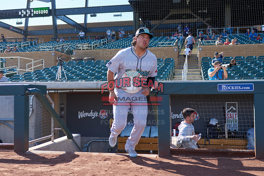 Salt River Rafters Colton Welker (34), of the Colorado Rockies organization, jogs onto the field during player introductions before the Arizona Fall League Championship Game against the Surprise Saguaros on October 26, 2019 at Salt River Fields at Talking Stick in Scottsdale, Arizona. The Rafters defeated the Saguaros 5-1. (Zachary Lucy/Four Seam Images)