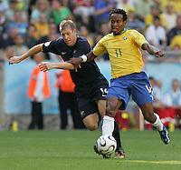 Brazilian midfielder (11) Ze Roberto runs past Australian defender (14) Scott Chipperfield.  Brazil defeated Australia 2-0 in their FIFA World Cup Group F match at the FIFA World Cup Stadium, Munich, Germany, June 18, 2006.