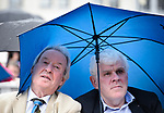 Councillors James Breen and Pat Daly share a brolly at the official opening of the All-Ireland Fleadh 2017 in Ennis. Photograph by John Kelly.
