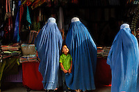 "Mazar-E-Sharif, Afghanistan<br /> Are you my mother?   <br /> I watched with amusement as this young child grabbed the hems of a few burkas before zoning in on her mother in a busy market place. As I moved through the cities and around the countryside women threw their burkas over my head. Ensconced in our secret tents they would kiss me three times on my cheeks and thank me for me for coming. I was often invited back into their homes with them where we would secretly share a cup of cardamom tea. <br /> <br /> Friday, a Muslim holiday, is a day off for everyone. Shops close, it is a day of rest. I soon discovered where the women go: Bagh-E-Zanana, commonly called the Women's Park. No men allowed. A small unkempt publicly owned area of land, it is a sacred space for women. Off come the shawls and burkas. The women are adorned in brightly colored dresses, long painted fingernails and heavy jewelry. They bring small picnics and snacks, beat tamborines, dance and gossip. They trade makeup, sunglasses and beauty tips. The young girls express themselves in clothes they would never dare to wear in public; hip hugging jeans, tight blouses, and they literally let their hair down. It is here, that on one day of the week, on one dry little patch of land in the corner of Kabul, the women of Afghanistan are free to throw off their burkas and dance.<br /> <br /> Afghanistan is such a beautiful country. I wanted to attempt to bring a face to the place, to portray a slice of life beyond a war zone. Still, it's obviously a challenging and dangerous place to photograph. Before I'd get in the car my driver would always scan underneath the vehicle for car bombs. Then he'd turn the key in the ignition with a prayer, ""Inshallah."" God willing.<br /> ""OK,"" I eventually told him, ""You really need to stop doing that because it's kind of starting to freak me out."""