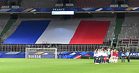 Both team line ups pictured with the French Flag ahead of the Womens International Friendly game between France and Switzerland at Stade Saint-Symphorien in Longeville-lès-Metz, France.