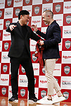 May 24, 2018, Tokyo, Japan - Spanish midfielder Andres Iniesta of former FC Barcelona hugs with Japan's online commerce giant Rakuten president Hiroshi Mikitani (L) as he joins Vissel Kobe of Japan's professional football league J-League in Tokyo on Thursday, May 24, 2018. Vissel Kobe is owned by Mikitani's Rakuten and Rakuten is now uniform sponsor of FC Barcelona.   (Photo by Yoshio Tsunoda/AFLO) LWX -ytd-