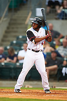 Arkansas Travelers second baseman Sherman Johnson (4) at bat during a game against the Corpus Christi Hooks on May 29, 2015 at Dickey-Stephens Park in Little Rock, Arkansas.  Corpus Christi defeated Arkansas 4-0 in a rain shortened game.  (Mike Janes/Four Seam Images)