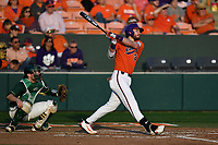 Right fielder Seth Beer (28) of the Clemson Tigers bats in a game against the William and Mary Tribe on February 16, 2018, at Doug Kingsmore Stadium in Clemson, South Carolina. The catcher is Hunter Smith. Clemson won, 5-4 in 10 innings. (Tom Priddy/Four Seam Images)