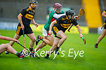Dr Crokes Cathal White under pressure as he clears his defence from Crotta's Donal Hunt in the Senior County Hurling championship, round 2 game.