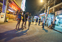 Prostitutes are seen on Fields Avenue, the main strip of bars offering cheap prostitutes that runs through Angeles City, Republic of the Philippines, 08 November 2014. The 'sin city', which sprung up on the fringes of a US Air Force base during the Vietnam war, has a reputation for cheap sex, and was a favourite destination for alleged murderer Rurik Jutting, who used to fly to Angeles City from Hong Kong for debauched weekends. The British banker is currently on remand at a secure facility in Hong Kong for allegedly murdering two Indonesian prostitutes in his flat whilst high on alcohol and cocaine.